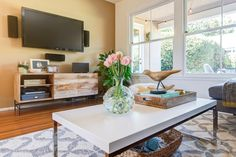 Rustic Storage Media Console + Tile Dhurrie Rug + Rocking Bird from west elm