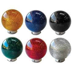 Add sparkle to your shifter with a round metal flake ball knob. Universal application to fit most shifters, these diameter shift knobs are available in six colors, each sold separately. Available colors: AMBER BLACK BLUE CLEAR GREEN RED Car Gadgets, Cozy House, Flakes, Ford Falcon, Knob, Mustang, Metal, Motorcycles, Blue