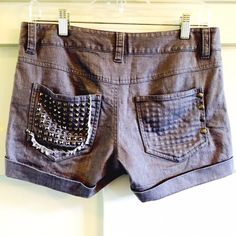 """Alice + Olivia grey studded denim shorts NWOT These cuffed denim shorts feature 5-pocket styling and a single-button closure. Pyramid studs at coin pocket. Pyramid studs and frayed edge at left back pocket. 4-snap overlay and pyramid studs at right back pocket. Only wore once.  * 8.5"""" rise. 3"""" inseam. * Fabrication: Stretch denim. * Body: 98% cotton/2% spandex. * Lining: 100% cotton. Alice + Olivia Shorts"""