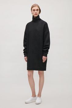 An oversized style and fit, this sweatshirt style dress is made with extra-long sleeves that are designed to be gathered on the arm. Made from cotton jersey with a melange finish, it has a standing high-neck, dropped shoulders and a simple, straight hemli