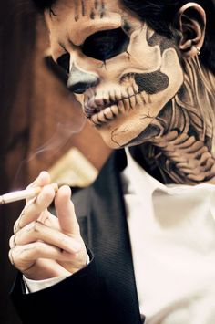 Skeleton themed Halloween makeup. Who says you can't be a dashing skeleton on Halloween? With this ensemble of intricate makeup brush strokes, you might get more than a few good looks from spooky admirers.