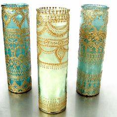 Decorate glass with gold puff paint! The possibilities are endless with metallic colored paint. I always love candle holders, and the idea would be great for a party.