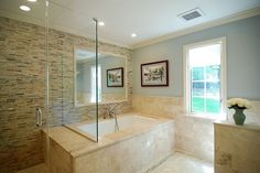 Tub/ bath combo, note seat for shower.  Half wall to right is toilet. Tile honed travertine and mosaic. | Yelp