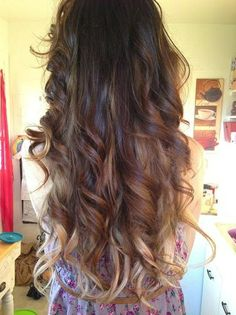 Gorgeous long curled, brunette locks with light tips.