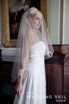 Wedding Veil CASSANDRA: CASSANDRA is a gorgeous two layer hip length veil with a pencil finish and exquisite 3D crystal beaded lace motifs. Short veil, hair up, over face, blonde bride.