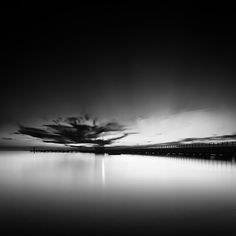 Clouds And Pier by Ozkan Konu on Art Limited