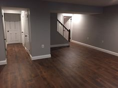 Mohawk Midday Mocha Oak laminate flooring and Behr's Gentle Rain paint Basement Walls, Basement Bedrooms, Basement Flooring, Basement Ideas, Basement Bathroom, Basement Decorating, Decorating Ideas, Basement Wall Colors, Dark Basement