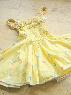 1950's girls yellow sundress.  https://www.etsy.com/listing/186852065/vintage-1950s-girls-sun-dress-romper