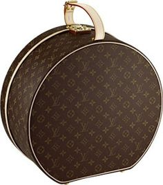 Louis Vuitton hat box. Would love to carry my Panama hat in this.