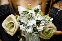 Bride requested bouquets not to be made of real flowers...thus each individual flower is made of burlap, silk ribbon, 2 dollar bills, glass flowers and sheet music from the song the groom performed for the bride as a surprise during the ceremony. The bouquet was meant to symbolize: prosperity (money flowers), clarity (glass flowers) and passion (sheet music flowers)