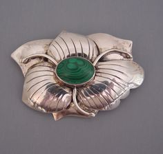 CAROL FELLEY - sterling silver and malachite stylized flower brooch - 1988