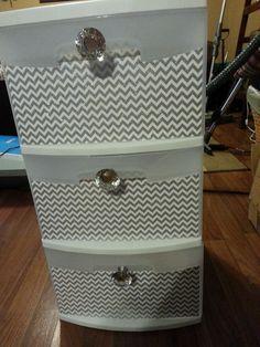 Sterilite storage drawer makeover. Some scrapbook paper, modge podge, and some fancy knobs.