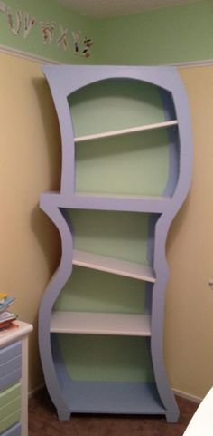 Dr Seuss bookcase | Do It Yourself Home Projects from Ana White.  I like the idea of slanted shelves because books won't fall over.