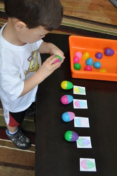 Match plastic Easter eggs to picture cards. Great toddler activity.