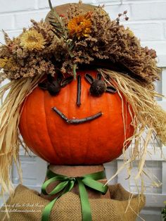 This charming pumpkin head can be used as a centerpiece for a table or on a outside chair to welcome friends and family.