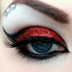 This is exactly how I want the Queen of Hearts makeup to be. It suits her personality perfectly. In the play, she's a very hot-tempered character and a very dramatic person. The red sparkling eye shadow represents her and how she's an evil person.