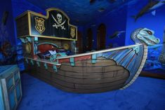WOW!         Pirate Ship Bedroom, Custom created pirate ship bunk bed and painted mural to match. Bunk bed is accessed by climbing the crates on the side of the ship which double as bookshelves., Front view of pirate ship bed. Dragon and all other parts hand sculpted., Boys Rooms Design