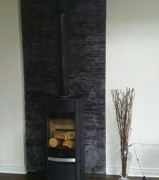 Choose from Decostones' expansive selection of stone cladding for your walls. We offer graphite, volcanic, natural stone and more. Pellet Stove, Stone Cladding, Stone Work, Wood Burning, Natural Stones, Home Appliances, Wood Stoves, Wall, Feather