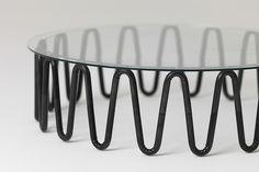 bardsley uses wrinkled steel tubes for essenze furniture collection