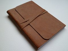 """Leather """"rustic"""" notebook, also from etsy. 28$, a bit overpriced, and I know that personally have a notebook that could be used for free."""