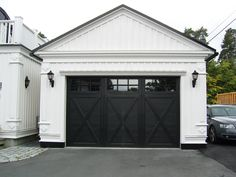 Did you remember to shut the garage door? Most smart garage door openers tell you if it's open or shut no matter where you are. A new garage door can boost your curb appeal and the value of your home. Black Garage Doors, Carriage Garage Doors, Garage Door Windows, Diy Garage Door, Modern Garage Doors, Garage Door Design, Garage House, Garage Ideas, Door Ideas