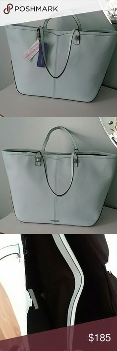 """Rebecca Minkoff everywhere tote Gorgeous leather tote in light mint. Very roomy, the inside features one large middle compartment with a zipper. 2 multifunction pockets and 1 zip interior pocket.  The exterior has a double strap with a 8 """" drop.  It's 19 """" across the top and 11.5 in height.  The bottom is 6.5 """" across.  Silvertone pyramid studs accent the handle base. Rebecca Minkoff Bags Totes"""