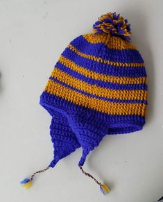 Keep warm all winter with this thick crochet hat with ear flaps. Crochet Plant Hanger, Knitted Hats, Crochet Hats, Hat Hanger, Rainbow Crochet, Ear Hats, Keep Warm, Blue Gold, Winter Hats