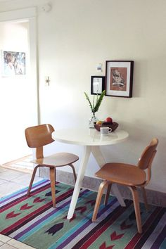 """Sneak Peek: A Seaside California Home Layered with Inspiration. """"We recently exchanged our large farm table for this cafe table from West Elm, and is a perfect fit for us in our kitchen. I discovered these chairs at a vintage shop who had recently acquired them from the Scientology Center in Los Angeles. We have a full set, but the other two are in the living room for when friends come over. The rug was a wonderful find from the Long Beach Flea Market."""" #sneakpeek"""