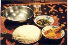 Zambian nshima (cooked from plain cornmeal), ndiwo (relish to serve with it), and eating customs.