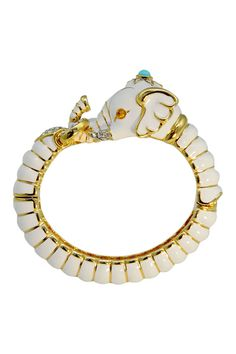 I am so intrigued by this bracelet.  Have been looking for something to wear with my orange dress.  Kind of love it.