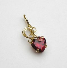 Ruby Heart Lab Grown Prong Set Swirls and Curls Gold Filled Wire Pendant by skezzcrom on Etsy