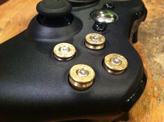 Xbox 9mm bullet button Controller Video Game Geekery gun brass shells handmade handcrafted handgun bullets games call of duty gears of war. $55.89, via Etsy.