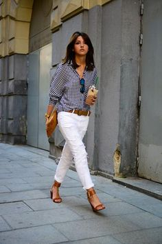How to wear white denim this summer! Pair white pants with classic navy print blouse and finish off with tan shoes and handbag.  Contrast is good.  Notice the front tuck on the blouse.  Very much in trend these days.