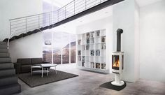 A modern stove no longer has to be a plain, boring iron square that sits awkwardly in your home. They are now elegant additions to modern homes. Modern Log Burners, Modern Wood Burning Stoves, Modern Stoves, Wood Stove Modern, Wood Stoves, Modern Fireplace, Fireplace Design, Direct Vent Gas Stove, Fireplace Inserts
