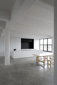 white and black kitchen concrete floor wood furniture Annemarie van Riet