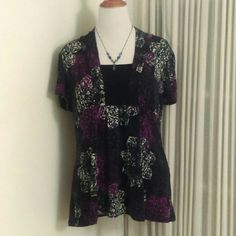 Vibrant Printed Shirt!! Brightly colored shirt with pinks and purples.  Great for the office as well as a night out to dinner!  Excellent condition!!  Stretchy fabric...In my opinion after trying it on, will fit a 1XL (smaller framed 2XL) much better. Perception Women Tops