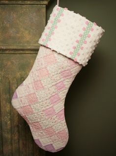 Antique quilt stocking... hmm gives me ideas on what to do with Great Grammas old blanket, would make a wonderful keepsake turning it into Christmas Stockings!