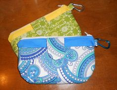 small clutch with front pocket and key holder