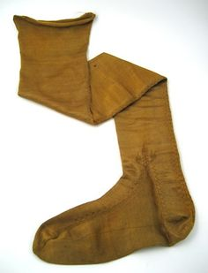 1650, Yellow silk stocking.Yellow, long and form-fitting silk stockings with seam at center back which runs down under the heel. The sock has hemstitching and a stylized floral decoration. Royal Armoury, Skokloster Castle and the Hallwyl Museum archives online, Inventory # 30875 (3395 C)