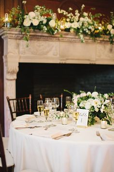 We love the flowers from Luna Moss on the mantle and reception tables at this winter wedding! It was cold outside but champagne, candles and pretty flowers will warm anyone up! Venue: Willowdale Estate, Topsfield Massachusetts  | Photography: Cuppa Photography - cuppaphotography.net/   Read More on SMP: http://www.stylemepretty.com/2016/10/26//