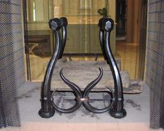 Forged fireplace log holder; very interesting design