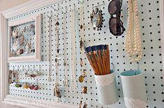 DIY:   Peg Board & Accessories Station - excellent tutorial shows how she made this station using peg board, moulding & hooks.  This is a great way to organize your jewelry & spruce up your space!
