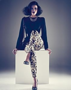 Love the printed pants with the black blouse.