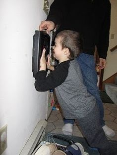 deep pressure input using scale  against wall/dad pushing down on shoulders...reward seeing numbers move