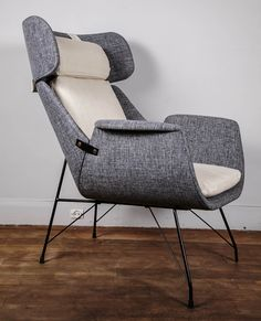 A Rare Pair of Lounge Chairs Designed by Augusto Bozzi for Saporiti   From a unique collection of antique and modern lounge chairs at http://www.1stdibs.com/furniture/seating/lounge-chairs/