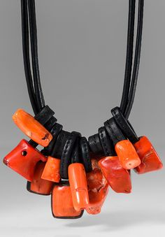 $1,595.00 | Monies UNIQUE Coral & Ebony Short Necklace | Monies jewelry is bold in design and strong in aesthetic. This Monies necklace is made with Coral, Copper, Ebony, and Leather, to become a unique coral orange statement piece. All pieces are handmade. Monies is sold online and in-store at Santa Fe Dry Goods & Workshop in Santa Fe, New Mexico.