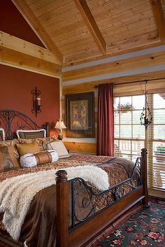 Room with a view. The master bedroom ensures that Pete and Trish can enjoy the glorious view without having to leave the comfort of their bed. The rich jewel-toned wall and the ornate textiles add elegant flair.