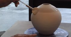 Marcia Selsor demonstrates her terra sigillata mixing technique and a feather and horsehair raku firing, which yields incredible results!