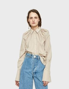 Button-down shirt from Rachel Comey in Khaki. Gathering from shoulders created volume and drape. Long sleeves with double-button cuffs. Fashion 2020, Daily Fashion, Faux Leather Dress, Fashion Forecasting, Bow Tops, Rachel Comey, Fashion Details, Hijab Fashion, Blouse