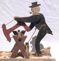 whimsical whirligig of a man sawing wood.